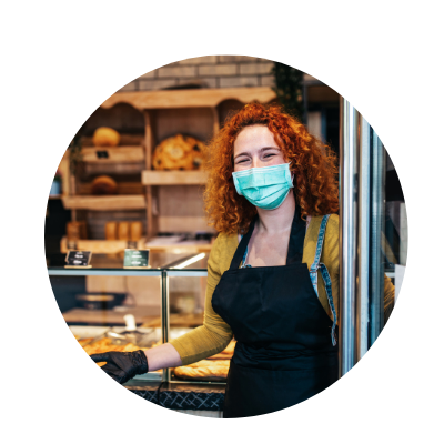 Baker in store wearing mask and glove